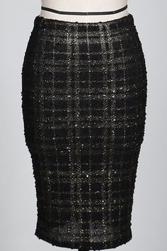 Looking to add a little F.U.N. to your work wardrobe? This skirt is so perfect with it's tweed like texture and nubby material. Add the allure of metallic studs that are actually sequins, strategicall