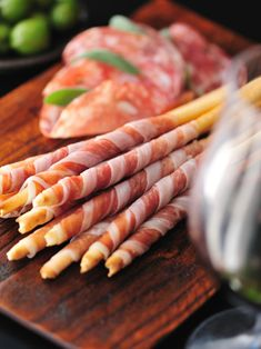 The perfect addition to your party platter. Wrap paper-thin slices of prosciutto around three-quarters of each bread stick and serve with assorted cheeses.