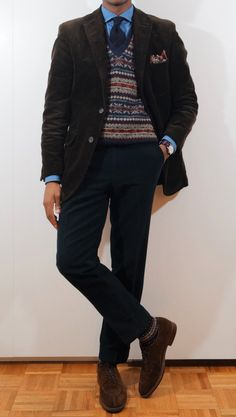 Dark brown corduroy jacket, blue shirt, navy tie, navy pants, blue fair isle vest