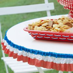 Party Decorations: Streamer Table Edging  Add some flair to your table at your Fourth of July party by adding a red, white, and blue crepe paper streamer around the edges. Apply double-stick tape to the edge of the table, pinch the crepe paper to create pleats, and place it on the tape. You also can run a stitch line through the crepe paper to create extra pleats.