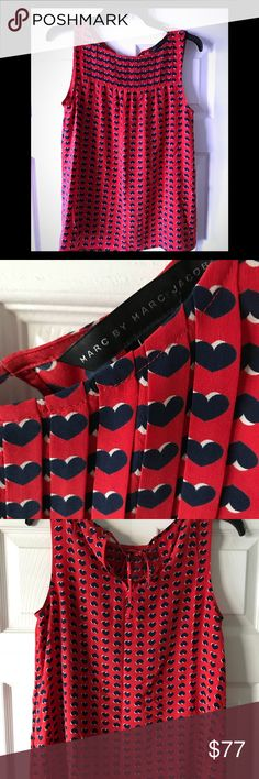 Marc Jacobs 100% silk heart top sz s Beautiful silk top from Marc Jacobs ,this top was worn by a Chicago model for a photo shoot and is now here for your consideration. Gorgeous red with navy blue hearts . This 100% silk top will take you from day at the office to out for dinner, dress it up or dress it down. Marc By Marc Jacobs Tops Blouses