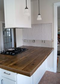 Love the look of the wood countertops, it adds the warmth that I am looking for - DIY Reclaimed Wood Countertop Reclaimed Wood Kitchen, Wood Countertops, Wood Kitchen Cabinets, Kitchen Upgrade Diy, Kitchen Upgrades, Rustic Kitchen Countertops, Diy Kitchen, Rustic Kitchen, Diy Countertops