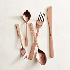 Featuring hammered handles, our copper-colored stainless steel Emery Flatware is attractive, practical and dishwasher-safe.