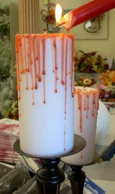 Bloody Pillar Candle ~ Light a red taper candle or melt a crayon and let it drip down onto the top and sides of the white candle