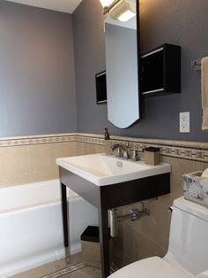 Deep purple walls look nice with tan tiles.
