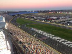 Charlotte Motor Speedway at dusk.