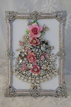 I LOVE this jeweled frame with the Christmas tree made of vintage jewelry....