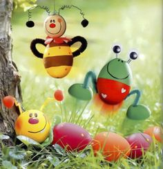 Frog, bee and caterpillar made of dyed eggs