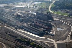 Facilities of the ArcelorMittal Cleveland site include #2 Steel Producing, which contains a BOF (Basic Oxygen Furnace) and caster, photographed on Thursday, September 22, 2016. At rear is Steelyard Commons, a shopping center that sits on land which was once a part of the LTV steel complex. (Thomas Ondrey/The Plain Dealer)