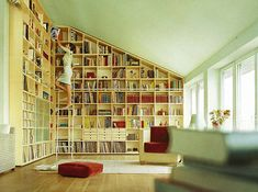 Love how these shelves organically slope with the roof. Source: lostinwords