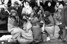 The Dawn of Camelot:  LIFE Magazine at JFK's Inauguration.  (PHOTO:  Men, women, and children -- bundled in sleeping bags, scarves, hats, gloves -- line Pennsylvania Avenue, January 20, 1961.)