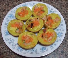 It is similar to banh xeo, except smaller. It is filled with shrimps and mung bean. The batter is made out of coconut milk and rice flour. I took the easy way out by buying a bag of banh khot flour. :)