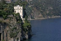 (Image-TripAdvisor Vacation Rentals) Spectacular Cliffside Villas: Villa Syrene, Amalfi Coast-Thanks to its extraordinary position on the Mediterranean's seafront, Villa Syrene enjoys stunning sea views of the entire Gulf of Naples, with Mount Vesuvius, the island of Procida and the Sorrento Coast right in front of you. A stay in Villa Syrene combines history with the utmost luxury on Italy's most scenic coast.