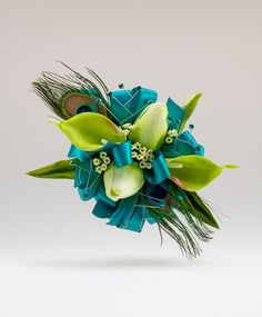 Calla Lily, Mini Tulips and Peacock Feather Corsage for Prom