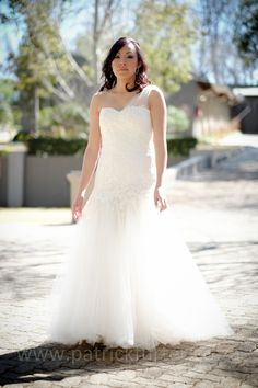 Kerryn looked exquisite in her unique Joss Bridal dress. Gorgeous lace for the fitted bodice, one soft tulle strap and a layered skirt with a subtle mermaid flare. Layered Skirt, Fitted Bodice, Bridal Dresses, One Shoulder Wedding Dress, Flare, Tulle, Mermaid, Couture, Unique