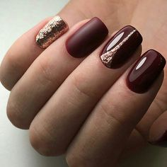 rich burgundy nails with gold accent