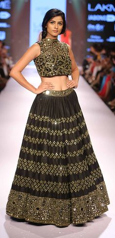 A model displays an intricate mirror work lehenga choli at one of the LFW events.(Source: StylingTheCity)