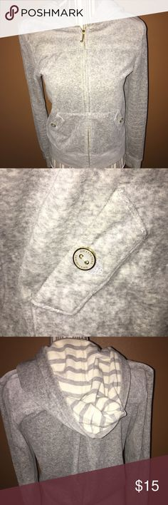 Juicy Couture Heather Grey Jacket Juicy Couture Long Sleeve Heather Grey Jacket. Inside side of hood is grey/white strip. White/gold button on pockets. End of zipper has a gold 'J' on the end. Juicy Couture Jackets & Coats
