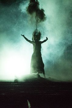 Antigone is burying her brother Polynices by throwing ashes in the air, Burgtheater 2015