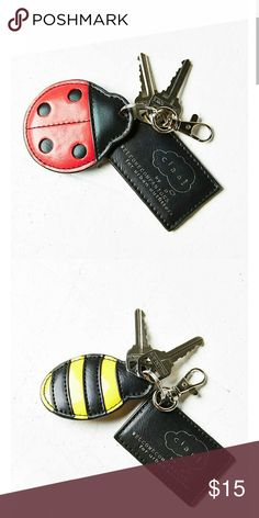Ladybug / bumblebee keychain Buzz away with these insanely cute little bug shaped keychains designed exclusively for UO by Welcome Companions. Vegan leather keychain with overlay accents and a branded tag. Finished with a metal hinge clip + key ring. Urban Outfitters Other