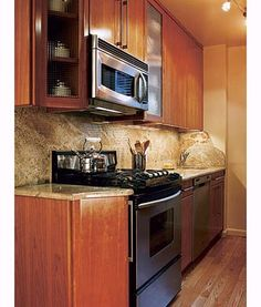 Michael's plan for the 7-by-10 foot galley kitchen was simple: use every available space efficiently, without changing the basic layout. So he moved the sink faucet into the corner and the microwave to over the range—the only configuration changes he made—freeing up counter space for food prep.