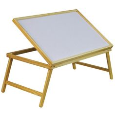 This attractive and functional Folding Adjustable Wooden Bed Tray makes breakfast in bed, reading or writing easier and more comfortable thanks to the cleverly-designed table top, which you can set at different angels to suit your needs and activities. The wooden legs in the bed tray fold out to be placed over your legs and the table top surface is laminated for easy cleaning. Is it ideal for use as a bed tray or lap tray in the bedroom or lounge.