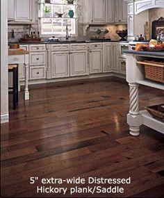 Distressed Hickory Plank Flooring. Wish my whole main floor had this flooring.
