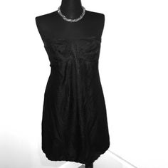 Like New! WHITE HOUSE BLACK MARKET STRAPLESS Black strapless dress with zipper enclosure in the back. Satin polkadot details with tweeting around the bust. Fully supportive bust. Dress has been worn once to a wedding. White House Black Market Dresses Strapless