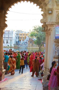 Colourful crowd - Hindus celebrate religious event on banks of holy river, India.