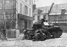 Swift work in the Danger Zone.    Their tank is a victim of a German bombing attack at a level-crossing in Northern France, the British crew immediately set to work to effect repairs to the damaged machine and render it fit for further service against the enemy.