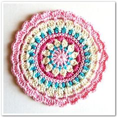 Little Spring Mandala by Barbara Smith, on Crochet: Made in K-town: Beautiful colors interesting rounds make this one a popular project!