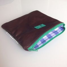 Handmade leather pouch with upcycled gingham cotton lining. Made in Italy by IT TAKES TWO