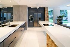 Solid Surface Countertops (Design Guide   Pros Latest Kitchen Designs, Kitchen Designs Photos, Modern Kitchen Island, Big Kitchen, Composite Flooring, Solid Surface Countertops, White Countertops, Tile Stores, Beautiful Home Designs