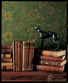 Pickering Hill: Antique books against a rich gold on green wallpaper. Ralph Lauren Home
