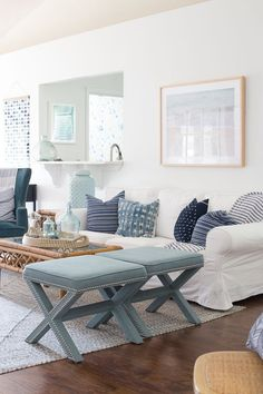 Love this light and bright coastal living room. Paint color is Benjamin Moore Chantilly Lace, IKEA Ektorp sofa, mix of blue throw pillows with natural wood accents.