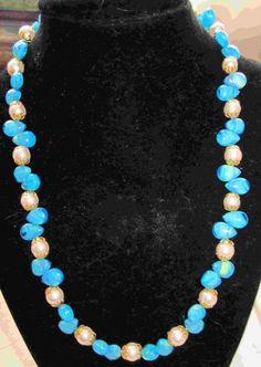 Bright blue necklace with white pearls and gold bead caps  20.00$
