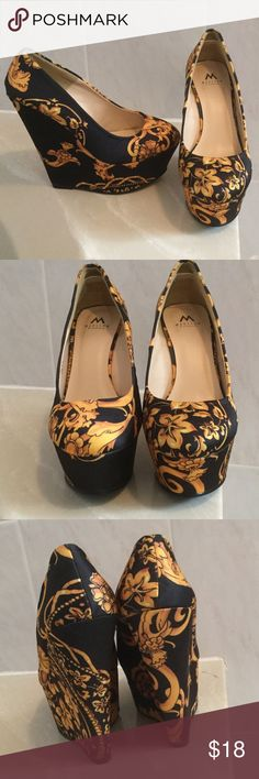 Yellow and black shoes Madison by Shoedazzle   Almost 6 inches high in the back and about 2 inches in the front.   Ask questions. No trades Madison by Shoedazzle Shoes Platforms