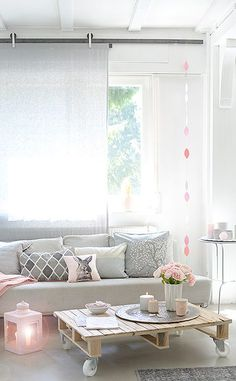 Love the combination of grey furniture and soft pink touches.