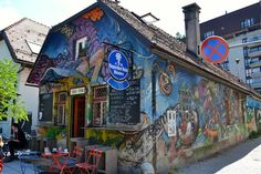 It is called the Sax Pub.  Sax pub, immediately recognizable for its colourful façade covered in graffiti, is a great place to enjoy a mug of beer while listening to jazz music.