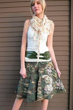 "embroidered camo skirt - if you are going to add a layer think ""non-camo/military"" - short black leather moto jacket - cropped creme kimono cardigan - use same green belt shown to belt the cardigan or a self belt for a simple color block look."