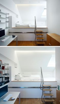 In this modern bedroom, the bed sits on a raised platform that is reached by climbing a set of small wood and stainless steel stairs.