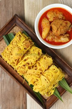 The Informal Chef: Roti Jala/Lacy Pancakes 网煎饼  This unique Malay delicacy pairs well with curries. It is a crepe presented in lace patterns.