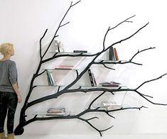 This tree bookshelf transforms literature into beautiful and functional wall art. Made using a real fallen tree branch, the shelf features an artistic and contemporary design that provides ample space at various height levels.