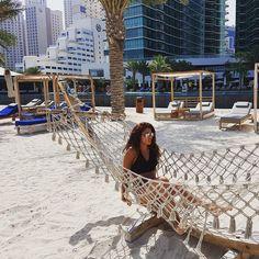 Not the comfiest of hammocks...   #beach #jbr #dubai #beachhair #hammocklife by @chi.charron