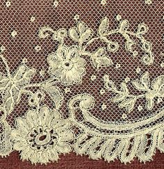 edging of Brussels Applique....Duchesse bobbin lace motifs are sewn onto machine made netting