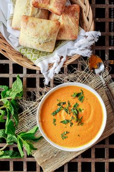 Roasted  Carrot Ginger Soup | The Mediterranean Dish. Flavor-packed with Mediterranean spices, fresh ginger and a little fresh mint.  This easy to prepare creamy soup is perfect for any season!  A new favorite in my house!