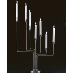 Elegant 7 armed candelabra from Piet Hein made of solid steel. Magnetic Knife Strip, Candles, Silver, Ideas, Kunst, Candy, Candle Sticks, Thoughts, Candle