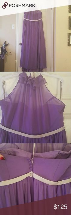 Purple halter top dress Purple bridesmaid's dress. Worn once. Halter top, low cut back with silver belt and partial button up back. Front has slit on left hand side. Dress has a train too. Unaltered, however the halter strap broke and I sewed it back on myself. Can be worn as a formal dress, bridesmaid's dress, or prom dress. Alfred Angelo Dresses