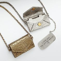 Vintage love letter necklace: The ink will never fade on this love note. Your clandestine message is engraved on a small letter kept inside the envelope-shaped locket. somebody tell him :) lol