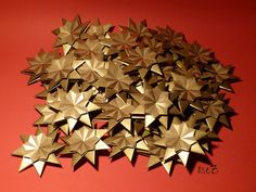 "Model: Star Franziska / Stern Franziska ; flat version Design/Author: Carmen Sprung Paper: simple metalized Kraft-Paper/ metallisiertes, einfaches Kraftpapier Size / Units: 8 squares of 7,5 x 7,5 cm for each star Diagram: in Carmen Sprung's wonderful book: ""21 Sterne"" Some evenings of star-folding to support my sister in law for children-singers (Children's Choir). If you try to count ....... here are 40 of them :))"